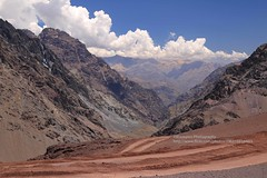 Paso Cristo Redentor de los Andes, view from Argentina to Chile (blauepics) Tags: argentina argentinien patagonia patagonien landscape landschaft hills hügel mountains berge mendoza province provinz provincia scenery desert stone steine sand blue sky blauer himmel andes anden clouds wolken cristo redentor de los chile station border grenze paso pass höhe altitude panorama view aussicht