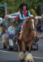 Riding Into Town (Scott 97006) Tags: horse ride woman parade outfit beauty street flowers festive