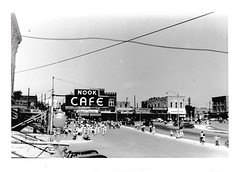 Weatherford Nook Cafe Parade July 8, 1949 (sdwalden6) Tags: weatherford weatherfordtexas weatherfordsquare courthouse weatherforddowntown 1949 1940s 1950s july1949 photograph blackandwhite vintage old retro antique monochrome road car intersection
