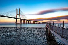 Sunset spot (Artur Tomaz Photography) Tags: clouds lisbon ponte vascodagama blue bridge depth nature orange river sunset tejo water