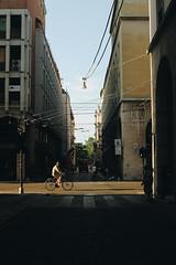 Scorci di città e fili dei bus (matteoguidetti) Tags: street urban city sun sunlight goldenhour golden bike man città strada urbanphotography streetphotography nofilter urbanlandscape canon eos parma italy italia