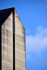 Skylines (James_D_Images) Tags: buidling architecture concrete geometry line angle sun shadow blue sky white clouds city skyline abstract weathered windows roof
