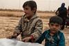 Arriving from Mosul (rvjak) Tags: campderéfugiésghazer irak iraq middleeast moyenorient refugees camp d750 nikon kids enfants garçons boys dirty poussière dust sale tired fatigué scared effrayé