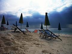 Where is everyone (leewoods106) Tags: krabi phuket thailand fareast asia southeastasia beach deckchairs chairs cloudy sea andamansea indianocean sand blue red yellow umbrella