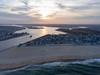 A DJI Phantom 4 drone hovers over the Atlantic Ocean, capturing a photo of Manasquan Beach. (apardavila) Tags: atlanticocean djiphantom4 jerseyshore manasquan manasquanbeach manasquaninlet aerial beachfronthomes clouds drone sky sun
