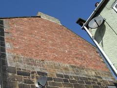 Wines Spirits ghost sign, Skelton (Nekoglyph) Tags: skelton cleveland urban brick wall gable ghostsign painted old advertising wines spirits alcohol letters satellitedish white stone