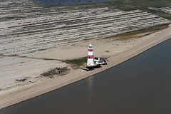 Still hanging on: Orfordness Lighthouse on Orford Ness in Suffolk - April 2018 aerial image (John D Fielding) Tags: orfordness lighthouse coast suffolk shingle shinglespit above aerial nikon d810 hires highresolution hirez highdefinition hidef britainfromtheair britainfromabove skyview aerialimage aerialphotography aerialimagesuk aerialview drone viewfromplane aerialengland britain johnfieldingaerialimages fullformat johnfieldingaerialimage johnfielding