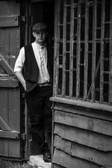 Farm Labourer (aljones27) Tags: bw monochrome blackandwhite farmlabourer labourer person portrait outbuilding door doorway rural your male man cap waistcoat agriculture museumofeastanglianlife stowmarket reenactors timelineevents