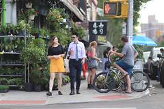 A couple at 1st Avenue and 7th Street. (kevinrubin) Tags: newyorkcity street streetphotography nyc newyork unitedstates us