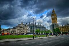 Parliament Square in London, United Kingdom (` Toshio ') Tags: toshio london england unitedkingdom uk westminsterpalace parliamentsquaregarden parliamentsquare parliament bus londoneye bigben fujixt2 xt2 europe european europeanunion city people clouds storm rain cityoflondon
