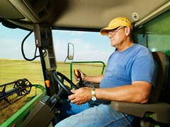 Stock Images (perfectionistreviews) Tags: colour color photograph image outdoors horizontal farm men adult man oneperson middleaged caucasian driver crop harvest combine farmer agricultural agriculture midwest farmland cultivation mowing harvesting driving northdakota harvester combineharvester equipment industryandagriculture usa