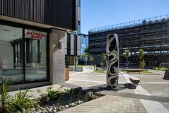 New Shop (Jocey K) Tags: newzealand nikond750 christchurch building architecture rebuild plants pattens carparkingbuilding shadows sky artwok shop signs cbd