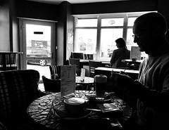 Cosy Cup Café, Blackpool (Rhisiart Hincks) Tags: ebarzh inside ytumewn istigh dubhagusgeal dubhagusbán zuribeltz gwennhadu kafe coffee coffi europe europa ewrop ue eu england lloegr lancashire sirgaerhirfryn silhouette silwét kafedi kafetegi duagwyn bw foxhall blackpool caife cafaidh café caffe