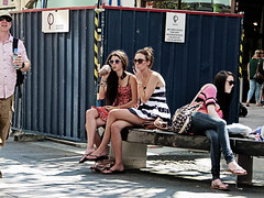 Inconvenience (Andy WXx2009) Tags: sitting bench people candid meeting outdoors urban bags cardiff shopping man walking wales europe girls streetphotography drinking sunglasses group smoking cigarette smoker brunette minidress jeans fashion style sexy legs feet beauty women femme female flipflops city street