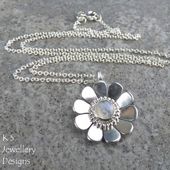 Rainbow Moonstone Shiny Daisy Sterling Silver Pendant (KSJewelleryDesigns) Tags: metalwork flower pendant necklace jewellery jewelry handmade brightsilver shine sterlingsilver silverjewellery handcrafted silver silverwire metal hammered shiny polished bright soldered soldering brushed flowers petals sawing piercing silversmith silversmithing daisy daisies blooms blossom gemstone cabochon flowerpendant swirlblossom texture stamens organic wirework stonesetting