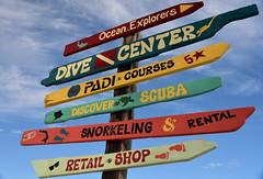 TBT Caribbean Sign Post (remiklitsch) Tags: tbt sign signpost colors caribbean stmaarten nikon remiklitsch red yellow green blue travel