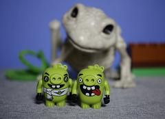 Uh, I think it's time for us to leave, Dear ! (N.the.Kudzu) Tags: tabletop lego minifigures piggy animal skeleton canondslr lensbabyburnside35 primelens manualfocus