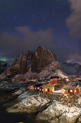 Hamnoy (Joost10000) Tags: mountain sky night stars sea ocean atlantic village aurora borealis auroraborealis lights northernlights northern arctic cold chill lapland norway norge norwegen noorwegen epic cabin fishing canon canon5d eos snow ice winter majestic europe red blue green
