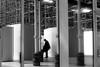 Under scaffolds (pascalcolin1) Tags: paris13 austerlitz femme woman gare station échafaudages scaffolds reflets reflection lumière light photoderue streetview urbanarte noiretblanc blackandwhite photopascalcolin 50mm canon50mm canon