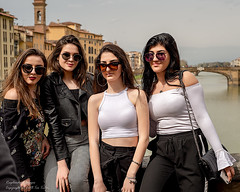 The view from Ponte Vecchio (Tex Texin) Tags: firenze florence italy tuscany girls quartet pretty ponte vecchio bridge arno river tourist strangers sunglasses people foursome quatro portrait sisterhood