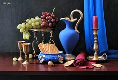 Priceless Things (Esther Spektor - Thanks for 12+millions views..) Tags: stilllife naturemorte bodegon naturezamorta stilleben naturamorta composition creativephotography art tabletop food grape cluster pitcher goblet stand candlestick napkin curtain waffle bowl candle metal ceramics brass ambientlight green burgundy golden blue brown estherspektor canon