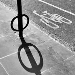 IMG_6513 (Kathi Huidobro) Tags: urban urbanscene shapes abstract roadmarkings signs traffic blackwhite bw monochrome london shadows contrast highcontrast texture patterns lines circles sunlight cyclinglane pavement shadow