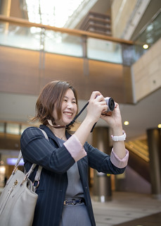 Young businesswoman taking picutures at airport