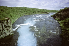 Downstream of Brúarfoss (hiphopmilk) Tags: copyright©jaredyehwooehmoehfilms nikonfm2n nikonfm2 nikon fm2 35mm 135film film analog analogue kodak nikkor hiphopmilk north europe nordic iceland brúarfoss bruarfoss waterfall blue water brekkuskógur brekkuskogur downstream river