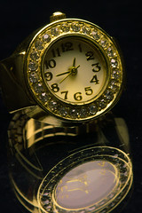 _1230821-1230825 (wiccan_two) Tags: gold jewelry apperal shiney black metal reflection ring watch clock time quartz diamond jewels hdr