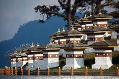 Bhutan: Chortens at Dochula Pass. (icarium82) Tags: bhutan travel canoneos5dmarkiv architecture captureone himalayas sigma100400mmf563dgoshsm tree chorten buddhist roadside dochulapass sundaylights