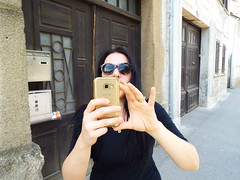 Nina's turn to take a photo (sean and nina) Tags: nina long dark brunette hair black clothes clothing mobile phone electronic device street outdoors outside candid public petrinja croatia croatian serb balkan balkans eu europe european sidewalk pavement path may spring 2018 jeans trainers sunglasses necklace face neck throat skin pink lips mouth arms hand bare beauty beautiful gorgeous stunning charm charming female girl lady woman girlfriend fiancee wife happy photo photographer