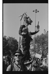 P62-2018-022 (lianefinch) Tags: argentique argentic analogique analog monochrome blackandwhite blackwhite bw bx noirblanc noiretblanc nb paris manif manifestation protest demonstration feteàmacron fête à macron street rue urban urbain france marionnette guignol puppet potaufeu pot au feu feteamacron lafeteamacron