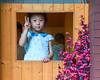 Play House 2 (C & R Driver-Burgess) Tags: pink cherry blossom blue print dress small kid child girl window playhouse playground kindergarten preschool wood brick wall building