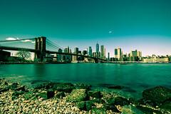 Manhattan daylight skyline (jornvk) Tags: nyc newyorkcity brooklynbridge hudsonriver longexposure skyline cityscape architecture bridge reflection river sky skyscraper view daylight building city water