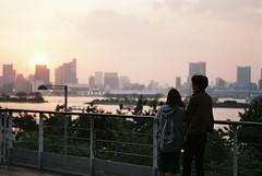 Staring at the Tokyo Skyline (yufa43) Tags: odaiba tokyo japan people couple skyline rainbowbridge