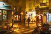 Paris nights-1 (albyn.davis) Tags: paris france europe people street light lights yellow gold color night couple shops shopping intersection windows signs shadows