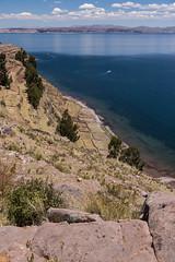 Taquile Island (ghostwheel_in_shadow) Tags: america laketiticaca peru southamerica taquileisland cliff island lake puno pe