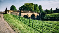 the bridge (khrawlings) Tags: river bridge house stately home chatsworth trees wood green grass rural derbyshire sky stone arches fence path