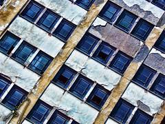 "rhythm (ingcuevas) Tags: antiguo deteriorado viejo vidrios rotos windows window blue colorful vibrant contrast rythm ritmo yellow line building wall architecture bright shine ""nikonflickraward"""