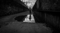 I went to the mirror (parenthesedemparenthese@yahoo.com) Tags: dem alley alone bw blackwandwhite clouds femme monochrome nb noiretblanc puddle reflection silhouette sky woman canoneos600d ciel dublin ef24mmf28 flaque howth ile ireland island loneliness nuages printemps seule solitude spring