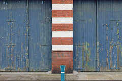 Stripes (sgreen757) Tags: avonmouth bristol bs11 fuji fujifilm x30 street peel peeled peeling paint garage door blue hinge crusty wood wooden red brick