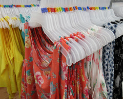 On the rack (Monceau) Tags: colorful womens tops rack store hangers hanging colorcoded hangingoutclothes clothes hangingout