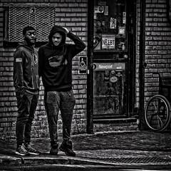 """Indecisivitis At The Street Corner"", ""Dude, How Many Streets Lights We Gonna Miss?"", Martin Luther King Jr. Avenue, Historic Anacostia, Washington, DC (Gerald L. Campbell) Tags: streetphotography street squareformat spirituality spiritualindifference socialdocumentary alienation aloneness bw blackwhite blackmale citylife community dc digital freedom historicanacostia indifference injustice inequality life martinlutherkingjravenue urbanphotography urban washingtondc yearning yeswecan youth canonsx60hs"