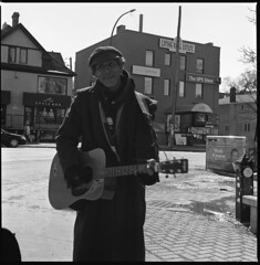 strummer (MarekSokal) Tags: mareksokal winnipeg thevillage hasselblad ilford panf boxspeed bw blackandwhite 500cm person guitar winter