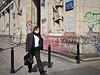 Warsaw -3221394 (Neil.Simmons) Tags: poland warsaw streetphotography people handbag coat street day businessman black suit graffiti man men walk candid tie