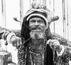 Belize Street Performer (photographyguy) Tags: blackandwhite bw streetperformer beads belize beard fireeating fireeater dreadlocks fire rastafarian man caribbean