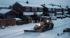 Snow in Suburbia. (ManOfYorkshire) Tags: snow winter 2018 suburbs suburbia urban estate private snowfall falling southyorkshire yorkshire tractor plough snowplough road housing dusk dark headlights