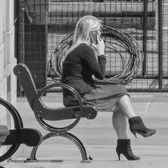 Smoke Break/ Phone Break (clarkcg photography) Tags: woman female blonde skirt heels boots bench sidewalk office break smoke phone wire roll cage construction tools parts cellphone smartphone iphone track know said done did called time howlong job blackandwhite blackwhite bw