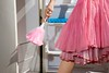 Stock Images (perfectionistreviews) Tags: outdoors horizontal caucasian person female youngadult cleaning chore housework domestic featherduster housewife homemaker closeup bodypart midadultwoman onepersononly 3035years leg skirt hand woman photograph household