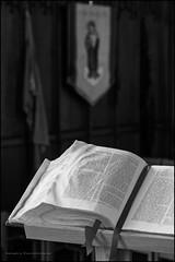 Luke 8.47 (Explored) (G. Postlethwaite esq.) Tags: bw bible derbyshire luke847 stmaryschurch uk wirksworth blackandwhite bokeh book depthoffield fairytales monochrome photoborder selectivefocus